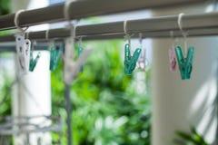 Зеленые clothespins Стоковое Изображение