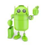 Зеленый андроид с shoping мешком иллюстрация штока