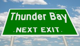 Зеленый знак шоссе для выхода Thunder Bay следующего стоковое фото