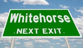Зеленый знак шоссе для выхода Whitehorse следующего стоковые изображения