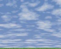 Зеленый лужок и голубое небо стоковые фотографии rf