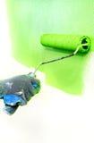 зеленый ролик удерживания руки Стоковое Изображение