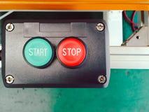 Зеленый старт и красный стоп дизайна кнопки переключателя установленного в блоке co Стоковое Изображение