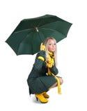 зеленый цвет девушки пальто над белизной зонтика Стоковые Фотографии RF