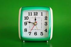 зеленый цвет часов предпосылки Стоковые Фото