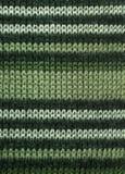 Зеленый цвет striped естественная текстура шерстей для предпосылки Селективный фокус стоковое изображение