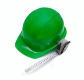 Зеленый шлем и измеряя лента Стоковая Фотография