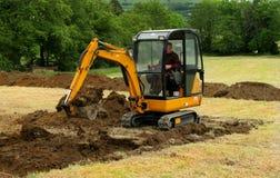 землекоп действия миниый стоковое изображение rf