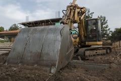 Землечерпалка на строительной площадке стоковые фото
