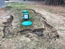 Земля вокруг тонуть канализационного резервуара Стоковые Фото