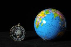 Земля и компас планеты стоковые фото