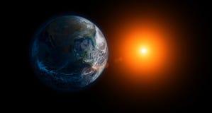 Земля и Солнце стоковые изображения
