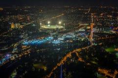 Земля и Yarra сверчка Мельбурна паркуют стадион тенниса загоренный на заходе солнца Стоковое Фото
