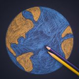 Земля планеты нарисованная с карандашами Стоковое фото RF