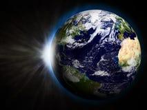 Земля с поднимая Sun Стоковые Фотографии RF