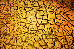земля треснутая предпосылкой сухая стоковые изображения rf