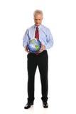 Земля удерживания бизнесмена Стоковые Изображения RF