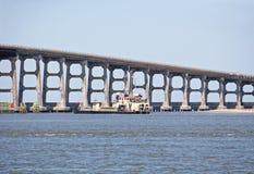 Земснаряд мостом стоковые фото