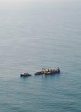 Земснаряд хоппера работая в гавани Стоковая Фотография