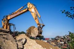 Землекоп, экскаватор и бульдозер строительной площадки промышленное машинное оборудование на строительной площадке Стоковые Изображения