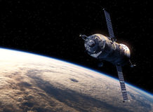Земля двигая по орбите корабля груза Стоковые Изображения