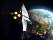 Земля двигая по орбите космического летательного аппарата многоразового использования Элементы этого изображения поставленные NAS Стоковая Фотография