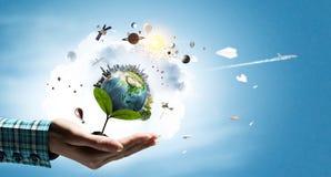 земля вручает нашу планету Стоковое Изображение RF