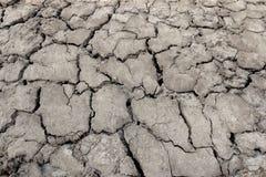 Земля засухи, треснутая земля Стоковые Изображения