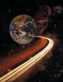 Земля и шоссе планеты в космосе Стоковое Изображение RF