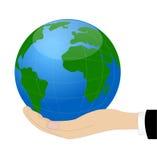 Земля планеты на руке Стоковые Изображения