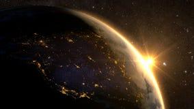 Земля планеты с эффектным восходом солнца, Стоковая Фотография RF