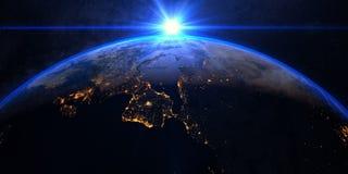 Земля планеты с эффектным восходом солнца Стоковая Фотография RF