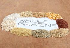 Зерна здоровой еды все на деревянной предпосылке стоковое изображение rf