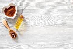 Зерна кофе, земной кофе и масло на деревянном copyspace взгляд сверху предпосылки Стоковые Фотографии RF