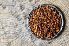 Зерна прополиса внутри плиты, продукта пчелы Стоковая Фотография