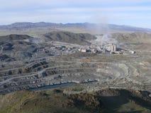 зернокомбайн извлекая гору Стоковое Изображение RF