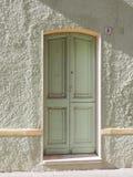 Зеленая дверь Carloforte, Isola di Сан Pietro, Sardin Стоковые Изображения