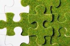 зеленая головоломка части Стоковое Изображение