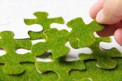 зеленая головоломка части Стоковое Фото