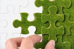 зеленая головоломка части Стоковое фото RF