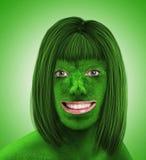 Зеленая женская голова на зеленом цвете Стоковое Изображение