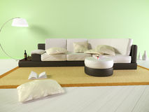 Зеленая живущая комната с софой и книгами стоковое фото rf