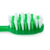 Зеленая зубная щетка изолированная над белой предпосылкой Стоковая Фотография RF