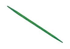 Зеленая зубочистка на белой предпосылке стоковое изображение rf