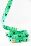 Зеленая измеряя лента на белой предпосылке Стоковое Изображение RF