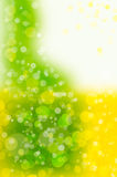 Зеленая и желтая предпосылка bokeh Стоковые Изображения