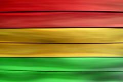 Зеленая красная желтая деревянная предпосылка листа (стиль регги) Стоковые Изображения RF