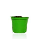 Зеленая маленькая почва бака и пригорошни для растущего завода Стоковые Фото
