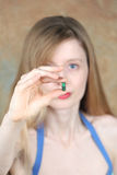 зеленая пилюлька микстуры Стоковое Фото