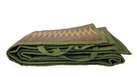 Зеленая портативная изолированная циновка Стоковые Изображения